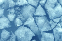 Broken Ice. Background as a concept of blue frigid cold temperatures as in the arctic polar climate with chunks of below zero frozen water representing cool Stock Photos