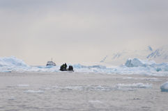 Broken ice and boat Royalty Free Stock Photo