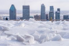 Broken ice after freezing rain and Montreal skyline. In background royalty free stock images