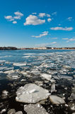 Broken ice pieces floating on river Stock Photo