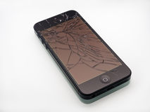 Broken iPhone with cracked screen. Los Angeles, CA, USA - December 07, 2015: Broken Apple iPhone with cracked screen on white background, selective focus royalty free stock image