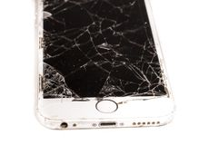 Broken iPhone 6S developed by the company Apple Inc. Paris, FRANCE - August 26, 2017: on a with background, a white iPhone 6S developed by the company Apple Inc royalty free stock photo