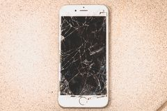 Broken iPhone 6S developed by the company Apple Inc royalty free stock photo