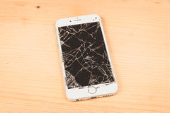 Broken iPhone 6S developed by the company Apple Inc royalty free stock photography