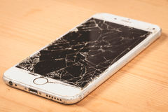 Broken iPhone 6S developed by the company Apple Inc stock photography