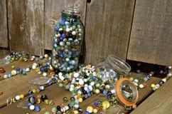 Broken jar of marbles Stock Image
