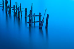 Broken Jetty on calm waters. Stock Image