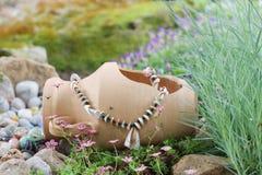 Broken jug in garden Stock Photos