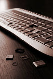 Broken Keyboard. A broken keyboard and a few keys lying next to it Royalty Free Stock Images