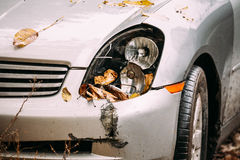 Broken Lamp Headlight And Bumper Car Scratched With Deep Damage Stock Image
