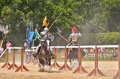 Broken Lances. Two armored Knights simultaneously break their lances tilting in the joust at a tournament Stock Images