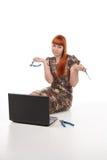 Broken laptop. Girl tries to repair broken laptop stock photo