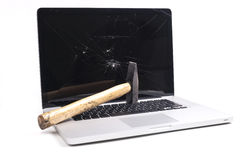 Broken Laptop. With smashed screen and a hammer isolated on white background stock photography