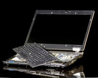 Broken Laptop computer with pieces Stock Photos