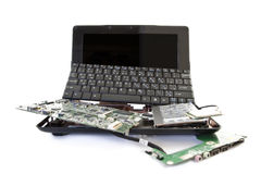 Broken laptop to pieces. Broken laptop disassembled into parts royalty free stock photography