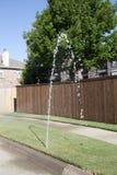 Broken  lawn sprinkler in community Stock Images
