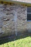Broken  lawn sprinkler Stock Photos