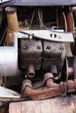 Broken Lawnmower Engine. Scrap-yard lawnmower engine awaiting recycling Royalty Free Stock Photos