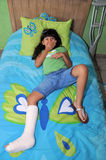 Broken leg. Image of a sad girl with a broken leg Stock Photography