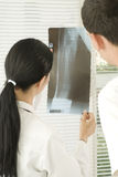Broken leg. Doctor and her patient looking at  x ray shot Royalty Free Stock Image