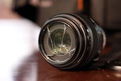 Broken Lens. Close up of a broken camera lens, isolated Stock Images
