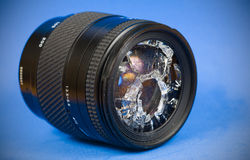 Broken lens. Smashed front glass in lens Royalty Free Stock Images