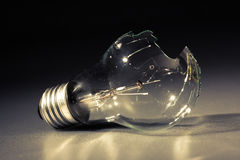 Broken light bulb Stock Image