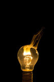 Broken light bulb burn out with flame Royalty Free Stock Photography