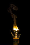 Broken light bulb burn out with flame Stock Image