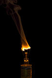 Broken light bulb burn out with flame royalty free stock photo