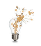 Broken light bulb with coins. Isolated on a white backgroundn royalty free stock photo