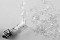 Broken light bulb. Shattered into small pieces Stock Photo