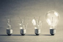 Better Idea to Success. Broken light bulb step to the perfect one, failure to success, improvement idea Royalty Free Stock Photos