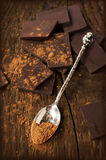 Broken line chocolate bar with a silver spoon Stock Photography