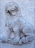 Broken lion sculpture Stock Images