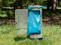 Broken litter bin in the park Stock Image