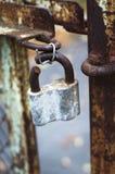 The broken lock. Rust broken lock in zoom view stock photos