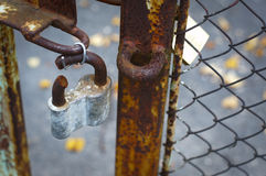 The broken lock. Rusted broken lock on the gates Royalty Free Stock Photography