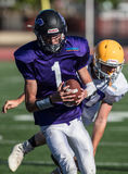 Broken Loose. NORCAL Lions Club All Star Football Team action in Oroville, California Stock Photo