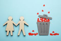 Broken love and dumped red hearts into dumpster. Divorce, parting couple stock photos