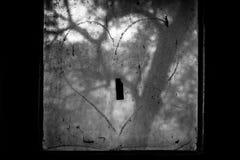Broken love on window Stock Photo