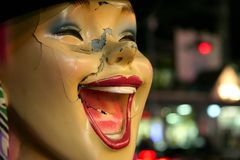 Broken mannequin. Closeup shot of a laughing broken mannequin face Royalty Free Stock Photography