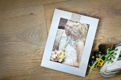 Broken marriage photo frame divorce. Broken photo frame of a married couple with children going for divorce Royalty Free Stock Photo