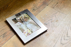 Broken marriage photo frame divorce. Broken photo frame of a married couple going for divorce Royalty Free Stock Image
