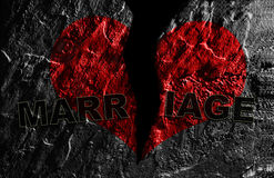 Broken marriage. Broken red heart on textured background with Marriage text Stock Images