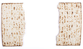 Broken Matza. Broken in half Jewish traditional Pesach textured Matza bread substitute isolated on white background Stock Images