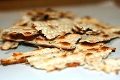 Broken matzo. Feast of Pesach. The Jewish Passover. Royalty Free Stock Photo