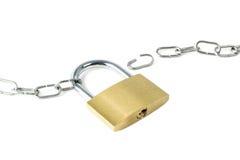 Broken metal chain and a locked padlock Stock Photos
