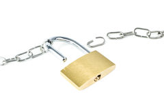 Broken metal chain and an unlocked padlock Royalty Free Stock Photo