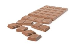 Broken milk chocolate bar Stock Photo